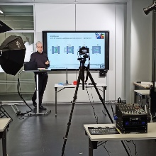 Peter Pott in front of a camera